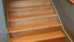 Dyfed Richards cladding staircase in Oak